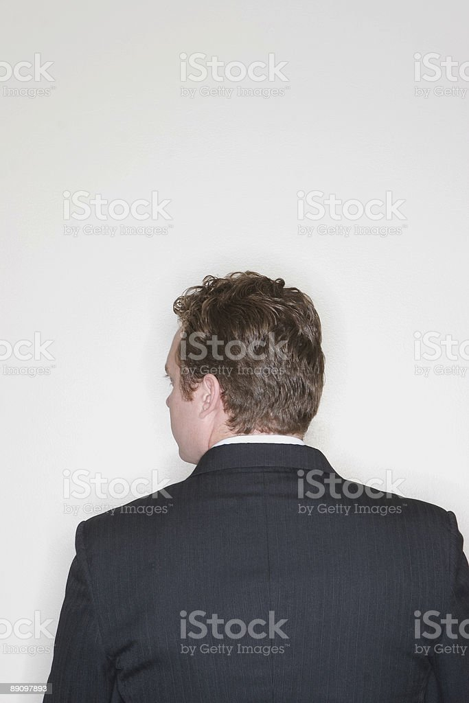 Businessman sitting and looking royalty-free stock photo