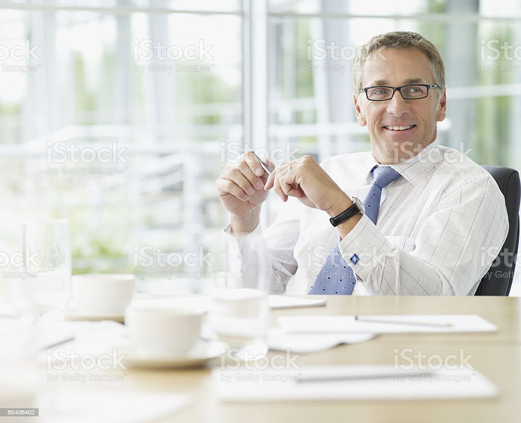 Businessman sitting at conference table royalty-free stock photo