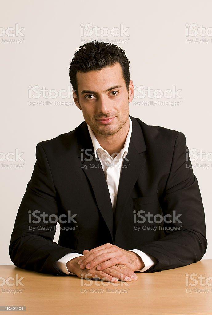 businessman sitting at desk royalty-free stock photo