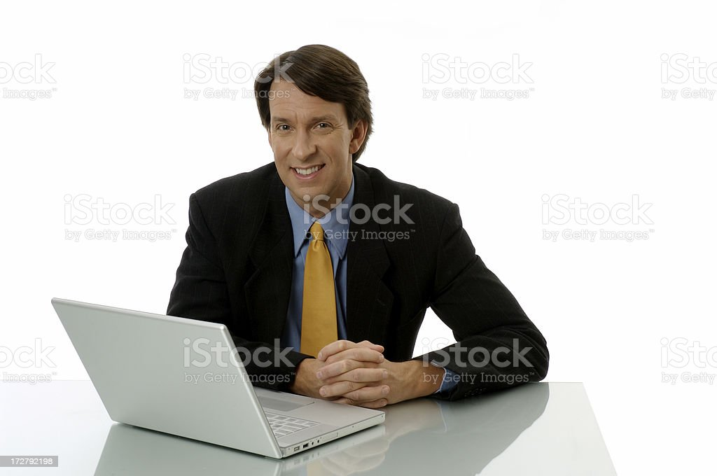 Businessman Sitting At Desk With Laptop royalty-free stock photo
