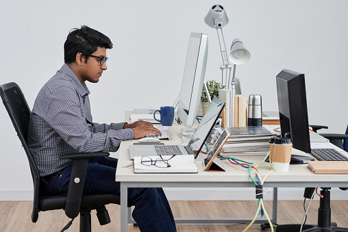 Businessman Sitting At His Workplace Stock Photo - Download Image Now