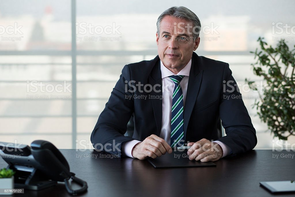 Businessman sitting at office stock photo