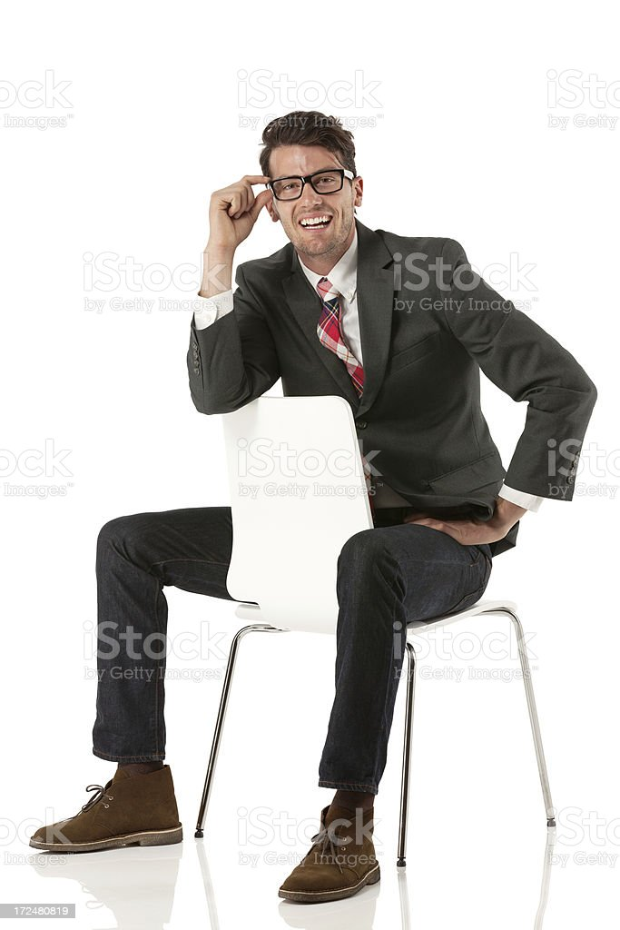 Businessman sitting backwards on a chair stock photo