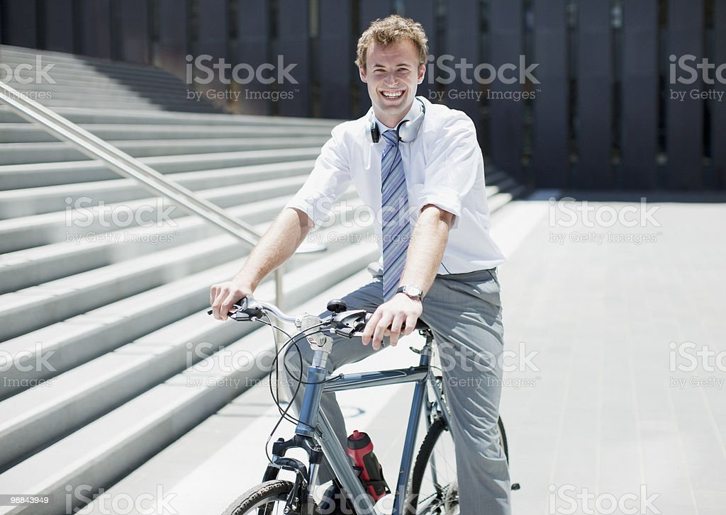 Businessman sitting bicycle royalty free stockfoto