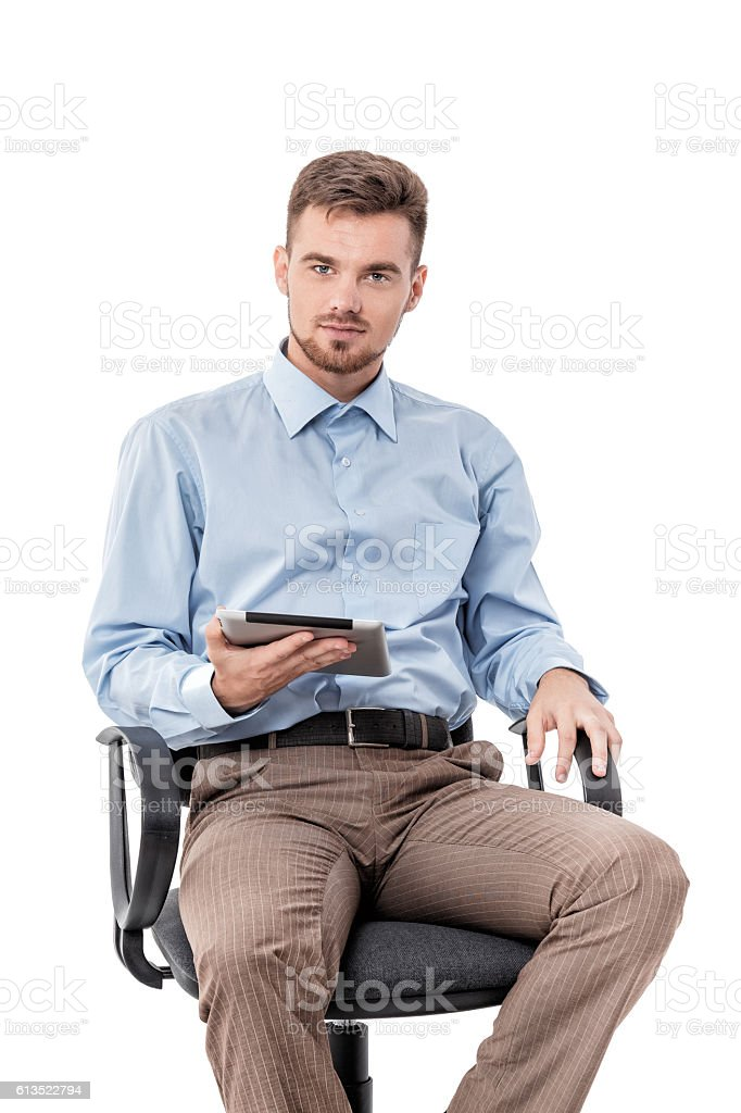 businessman  sitting in  chair and using tablet stock photo