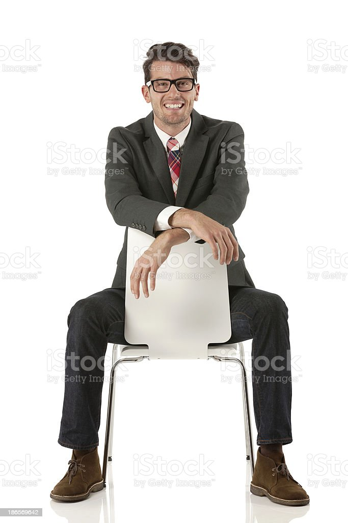 Businessman sitting on a chair back to front stock photo