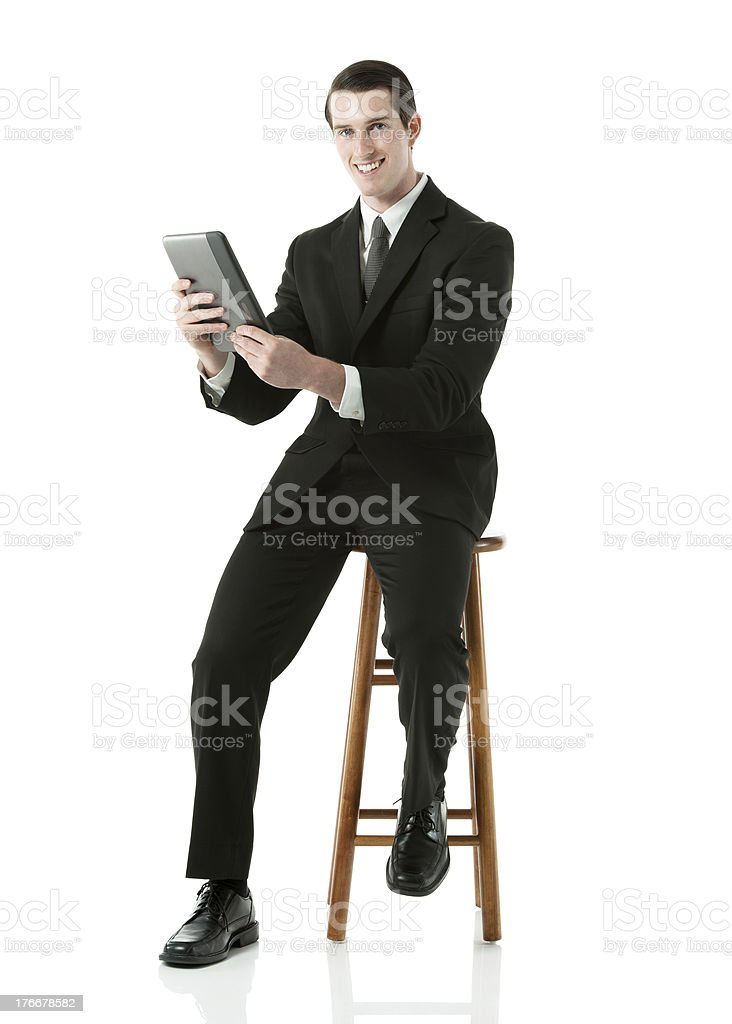 Businessman sitting on a stool royalty-free stock photo