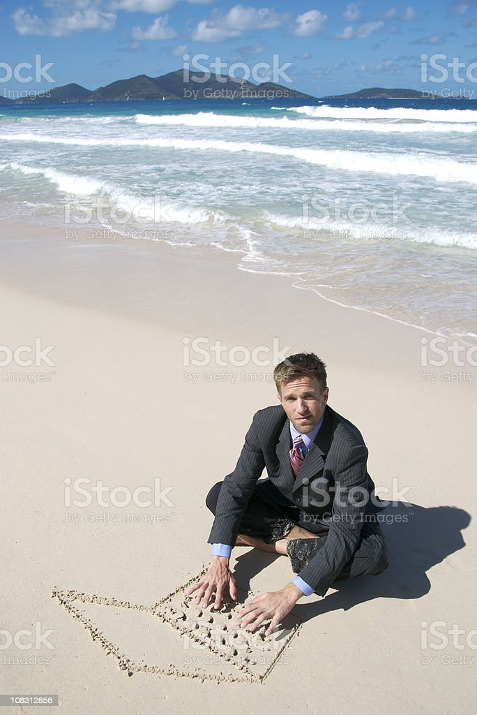 Businessman Sitting on Beach Typing with Sand Laptop stock photo