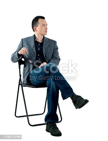 istock Businessman sitting on chair 1129270769