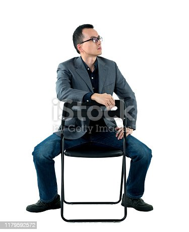 istock Businessman sitting on chair 1179592572