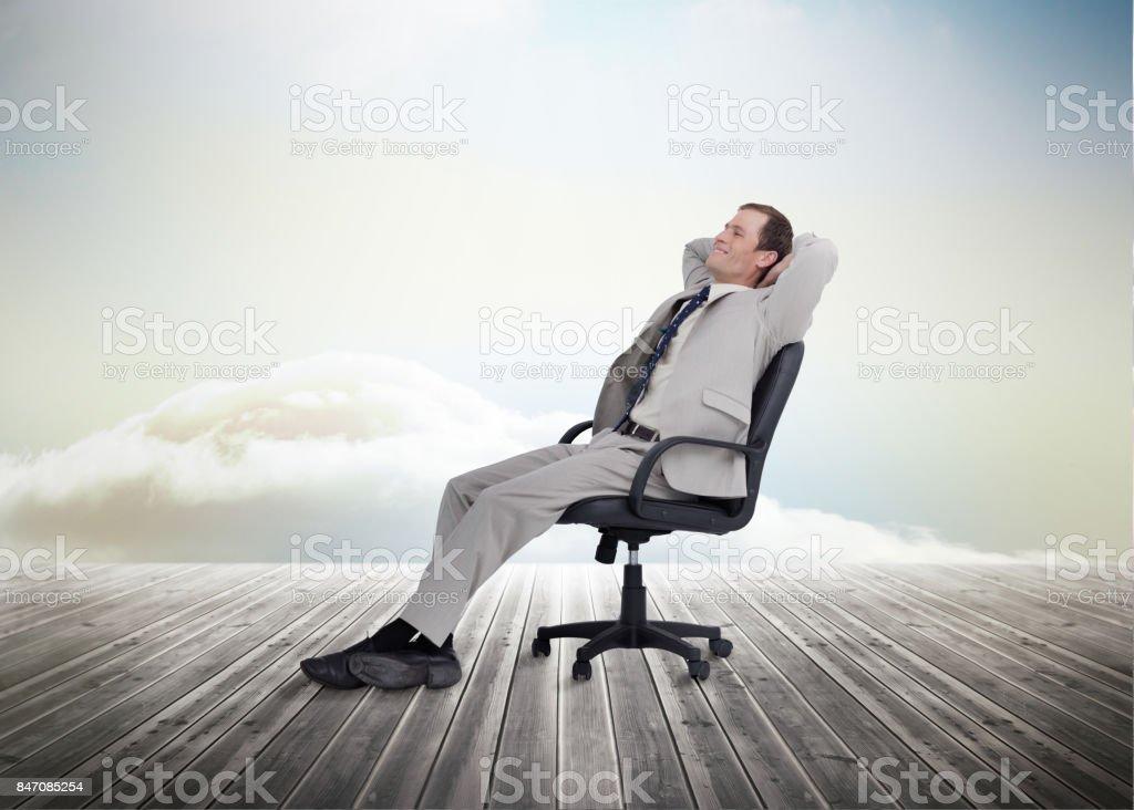 Businessman sitting on chair stock photo