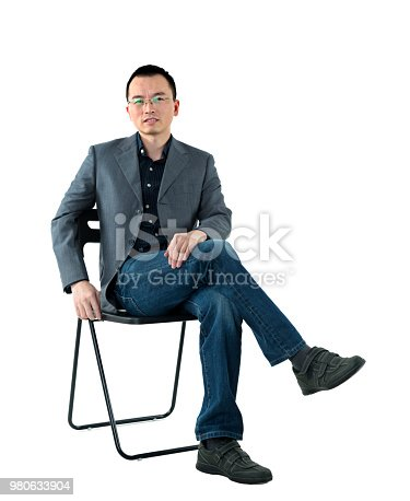 istock Businessman sitting on chair 980633904