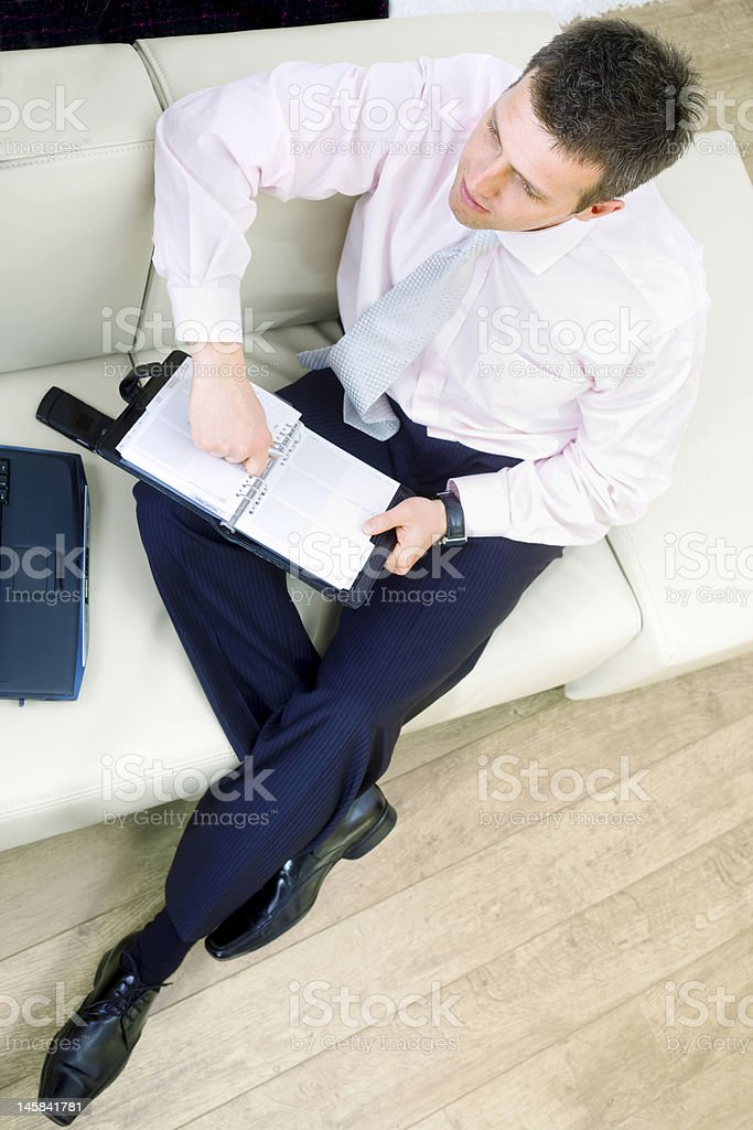 Businessman sitting on sofa royalty-free stock photo
