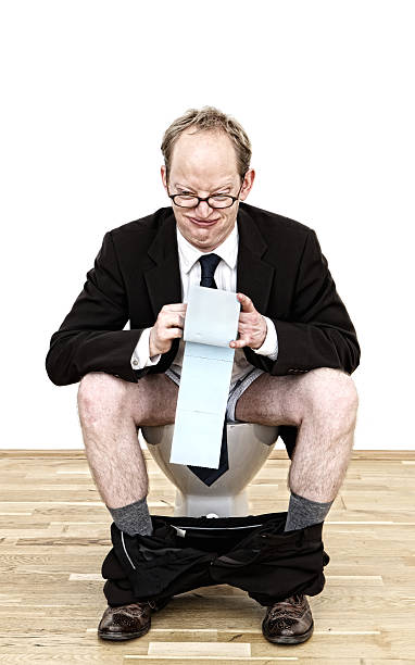 Businessman Sitting on Toilet stock photo