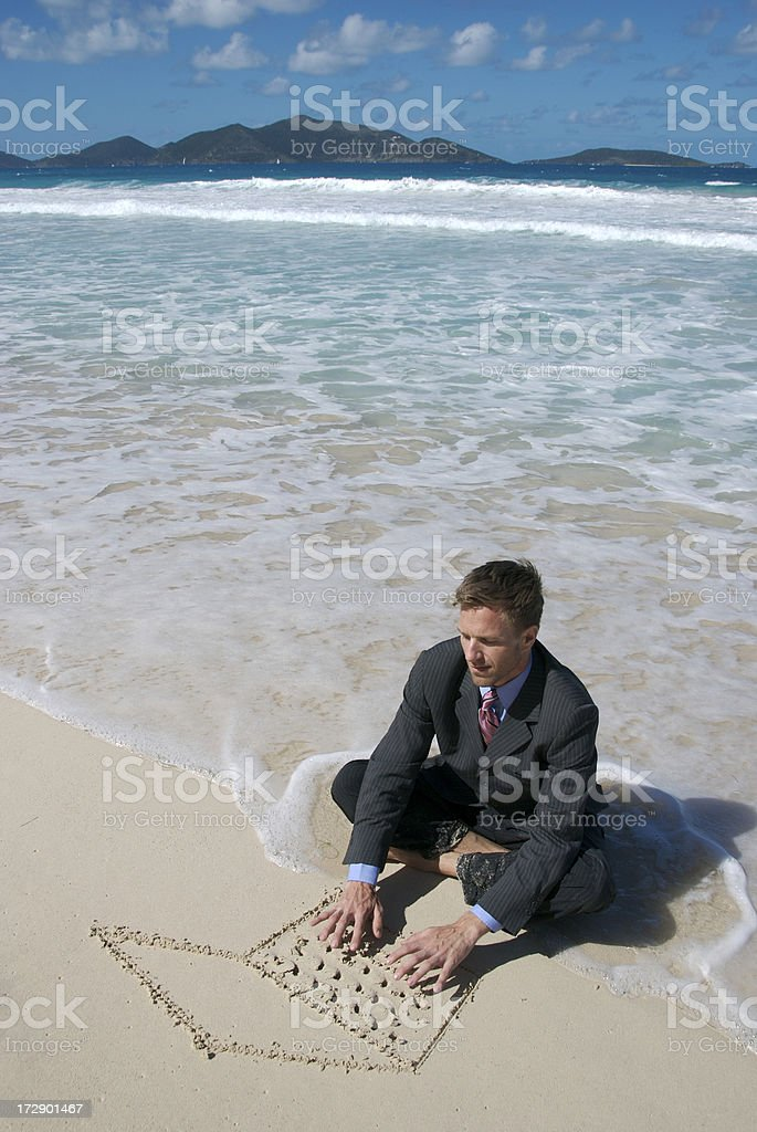 Businessman Sitting on Tropical Beach Working on Sand Laptop royalty-free stock photo