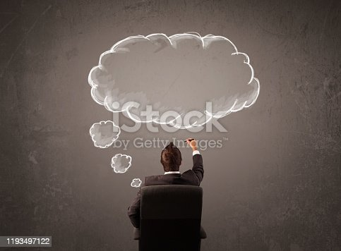 istock Businessman sitting with cloud thought above his head 1193497122