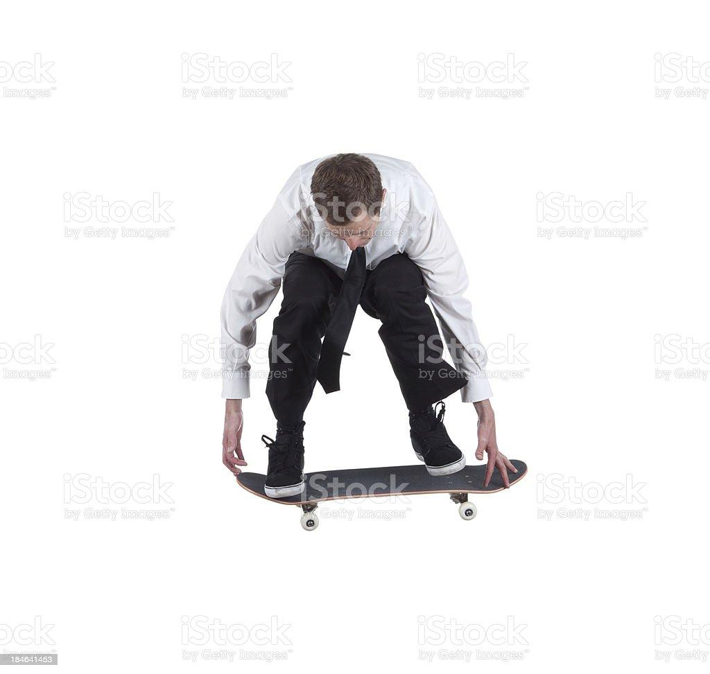 Businessman skateboarding royalty-free stock photo
