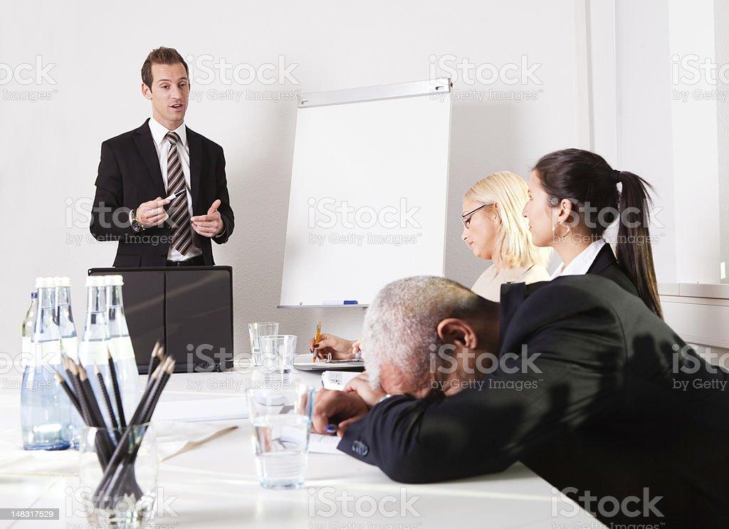 Businessman sleeping at the presentation stock photo