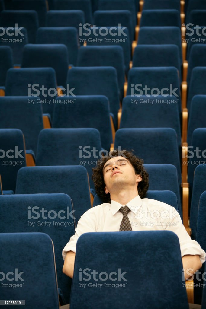 A businessman sleeping in a chair royalty-free stock photo