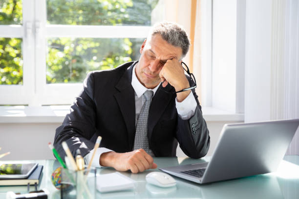 businessman sleeping in office - sleeping in work stock photos and pictures