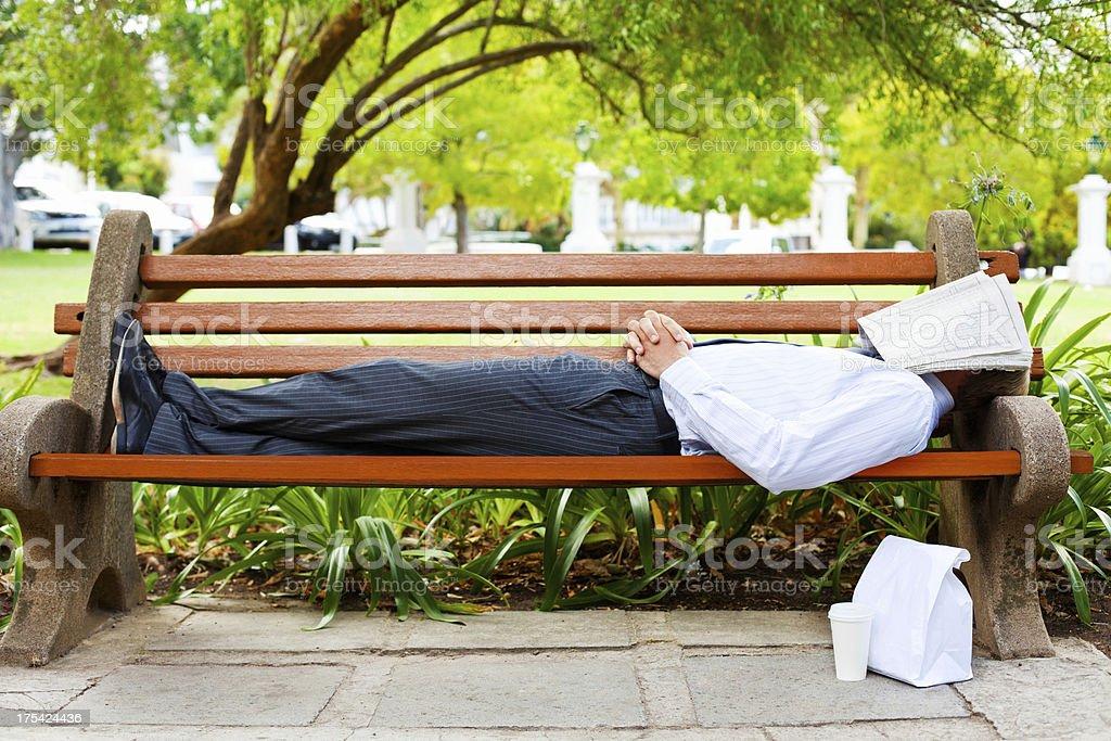 Businessman Sleeping On Park Bench royalty-free stock photo