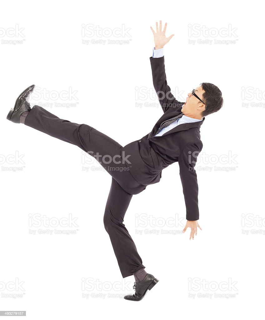 businessman slip and fall and  a funny pose stock photo