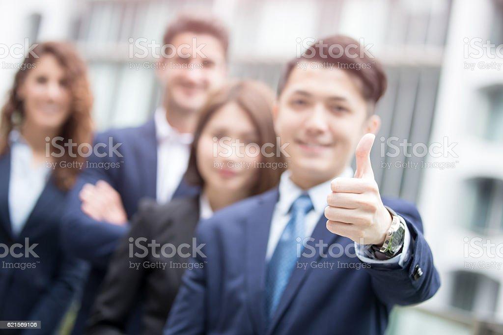 businessman smiles show thumb up Lizenzfreies stock-foto