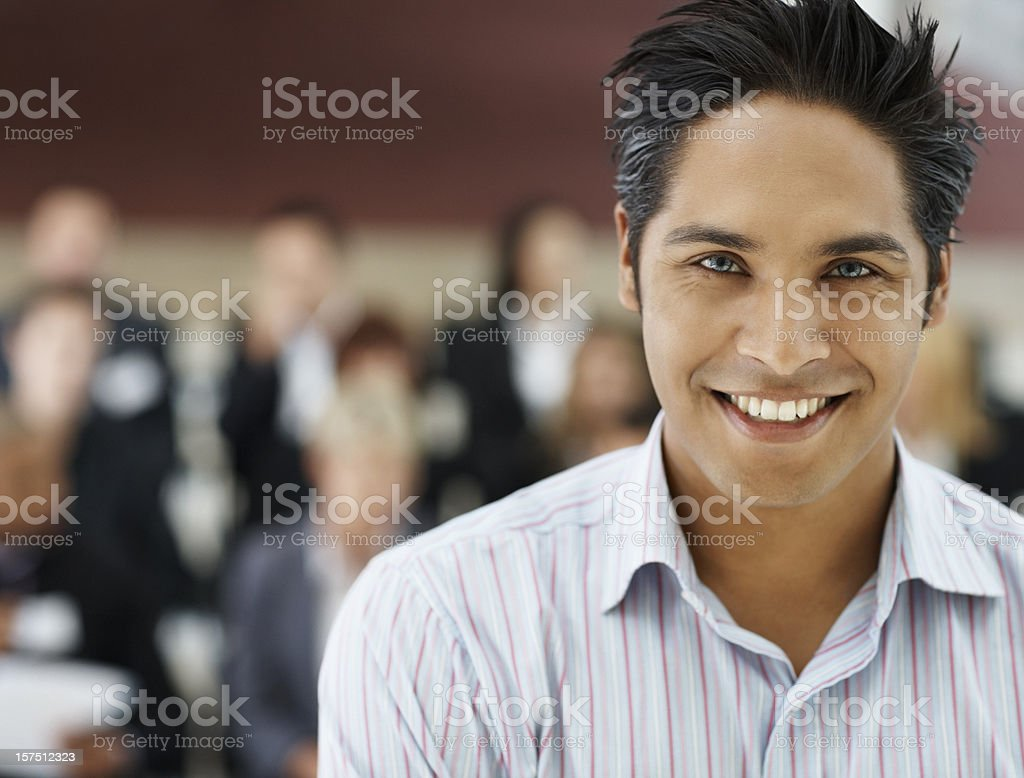 Businessman smiling at a seminar royalty-free stock photo