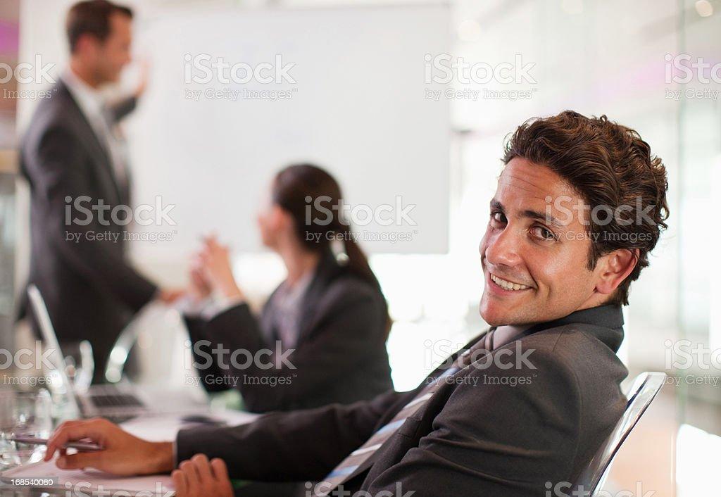 Businessman smiling at desk stock photo
