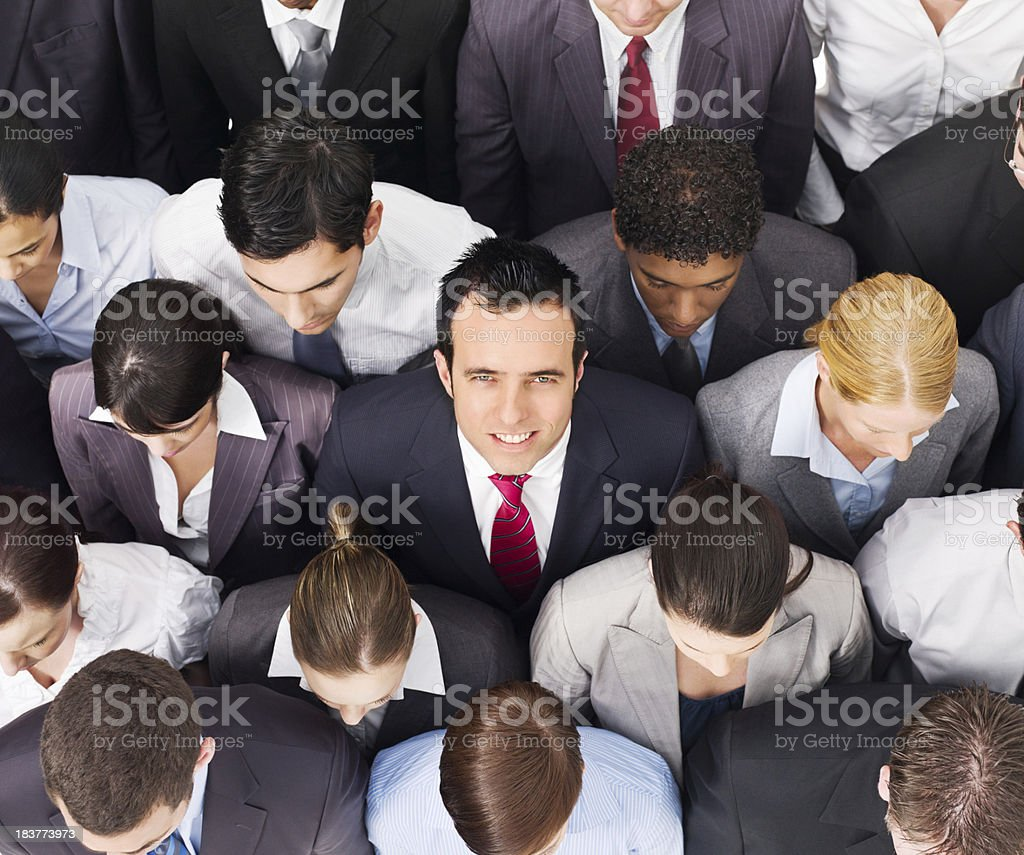 Businessman Smiling in a Crowd royalty-free stock photo