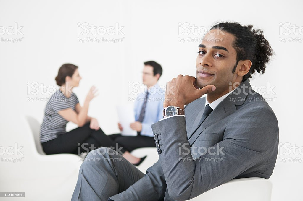 Businessman smiling in lobby area royalty-free stock photo