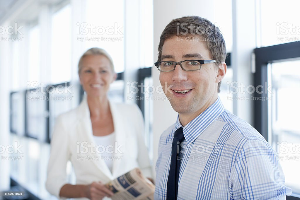 Businessman smiling in office royalty-free stock photo