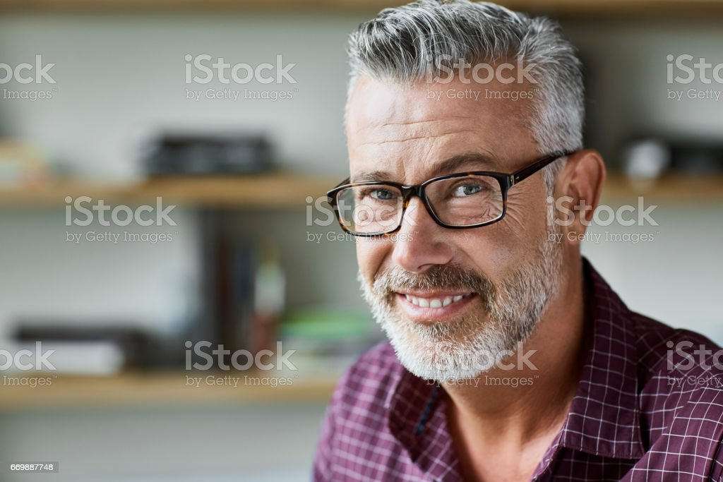 Businessman smiling in textile factory stock photo
