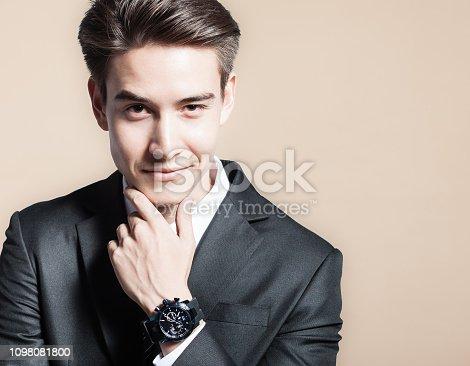 825082848istockphoto Businessman smiling 1098081800
