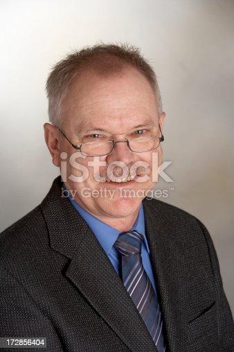 179607668 istock photo Businessman smiling 172856404