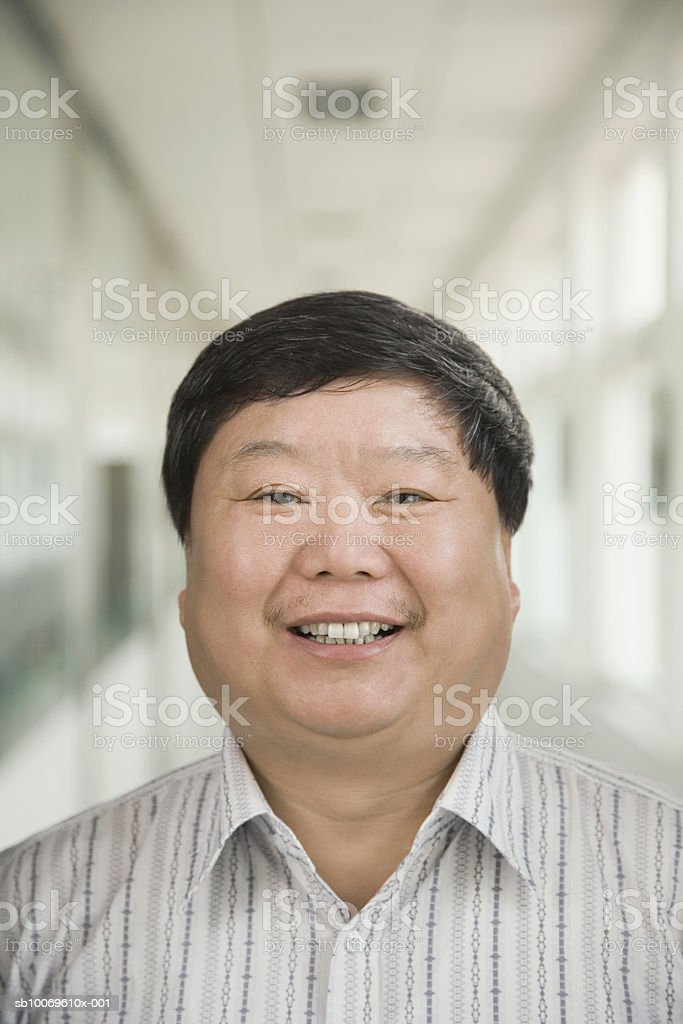 Businessman smiling, portrait, close-up Lizenzfreies stock-foto