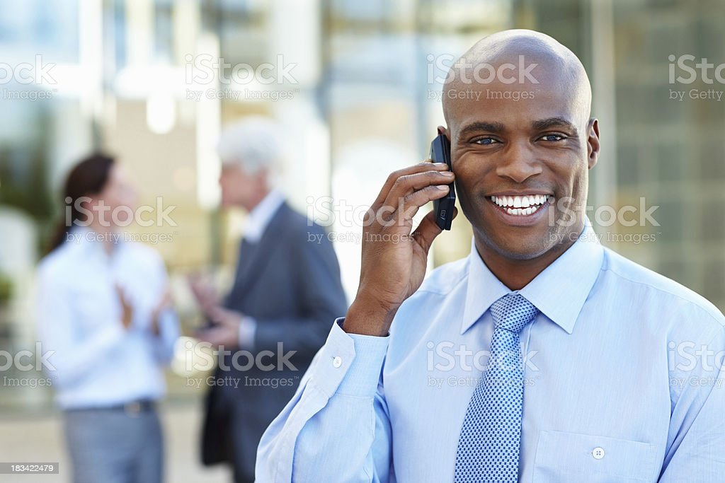 Businessman smiling while on phone call royalty-free stock photo