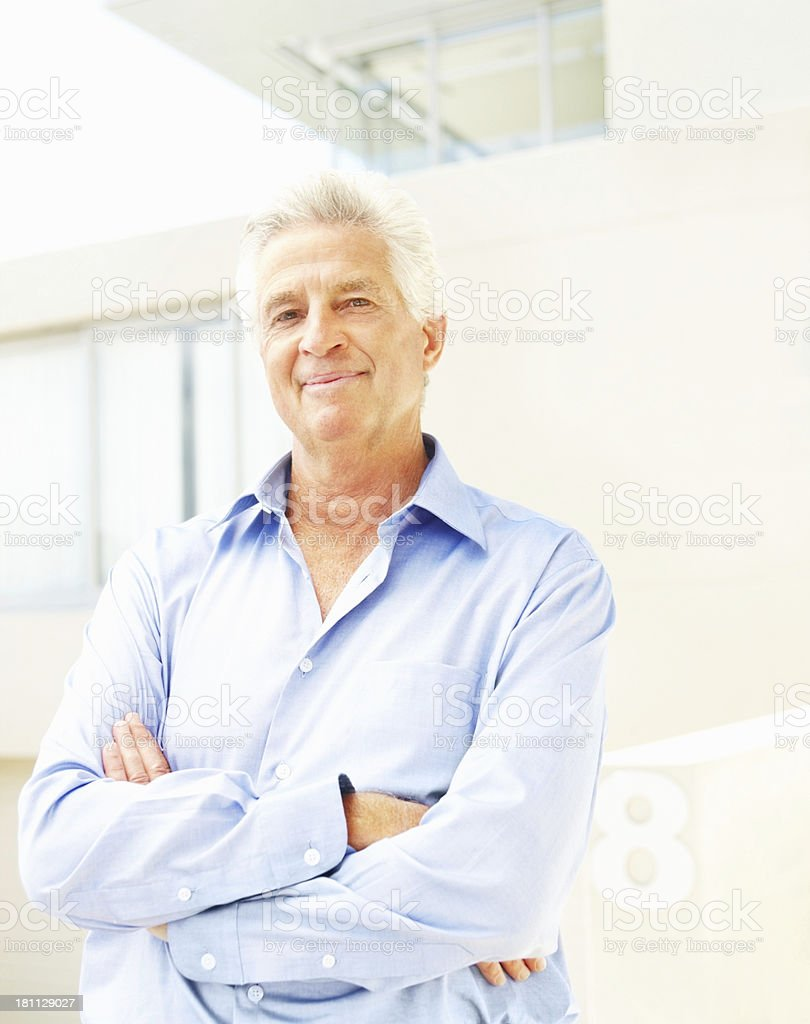 Businessman smiling with arms crossed royalty-free stock photo