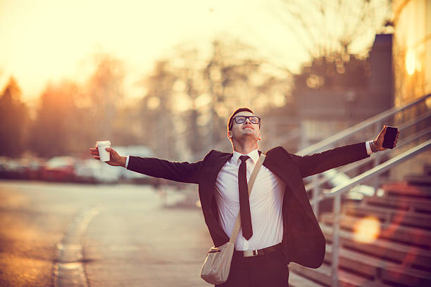 businessman smiling with arms outstretched - independence stock photos and pictures