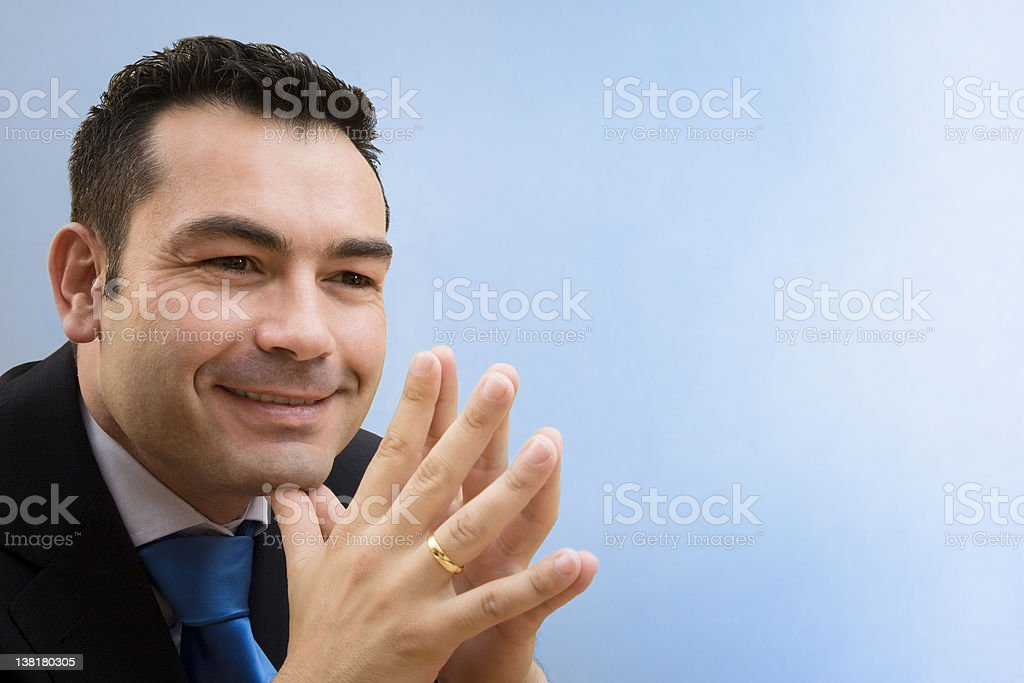 Businessman smiling  with blue background royalty-free stock photo