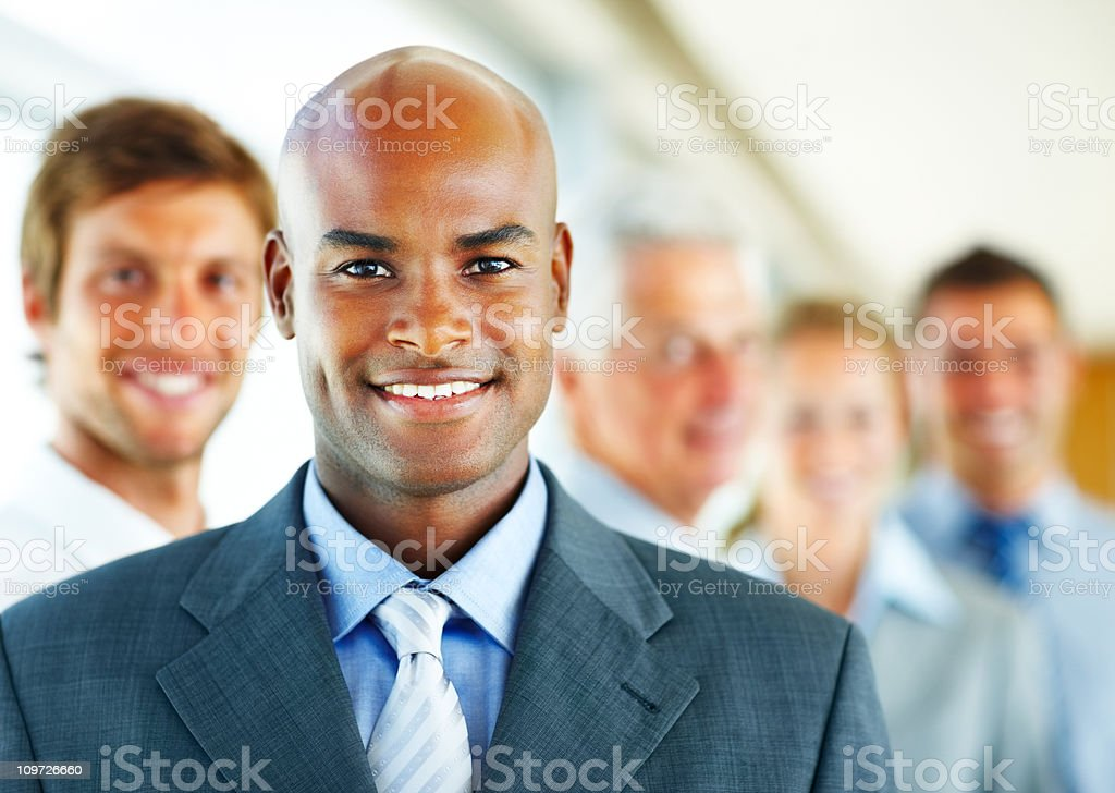 Businessman smiling with his colleagues in the background royalty-free stock photo
