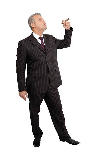 Businessman smoking cigar stock photo