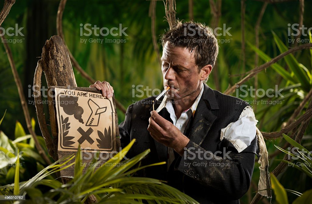 Businessman smoking in the jungle stock photo