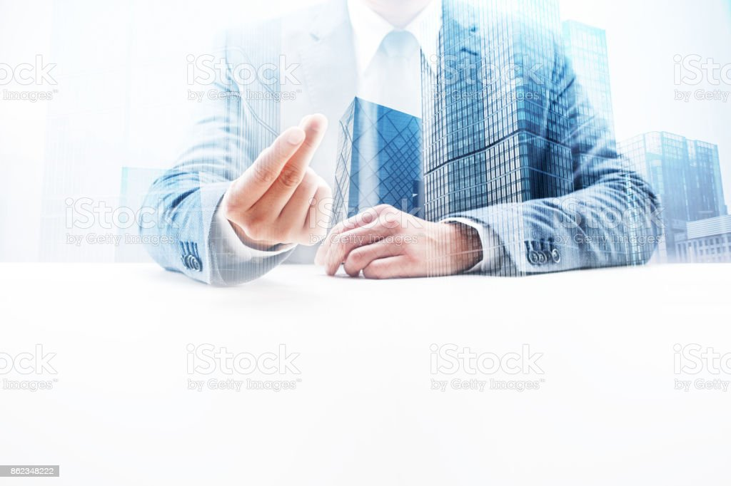 Businessman Snapping Fingers with Double Exposure Cityscape stock photo