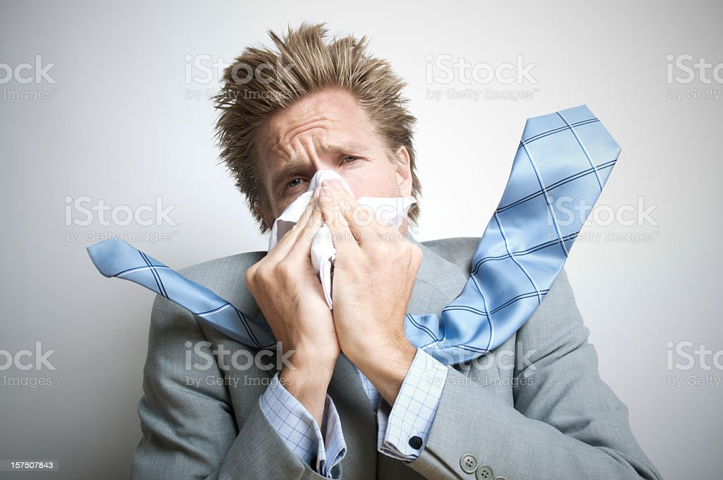 Businessman Sneezing Hard Enough for Tie to Go Flying royalty-free stock photo