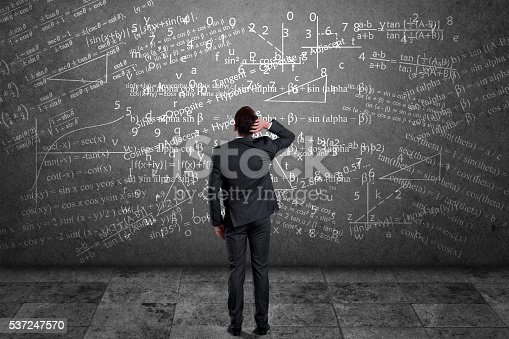 istock Businessman solving mathematical equation 537247570