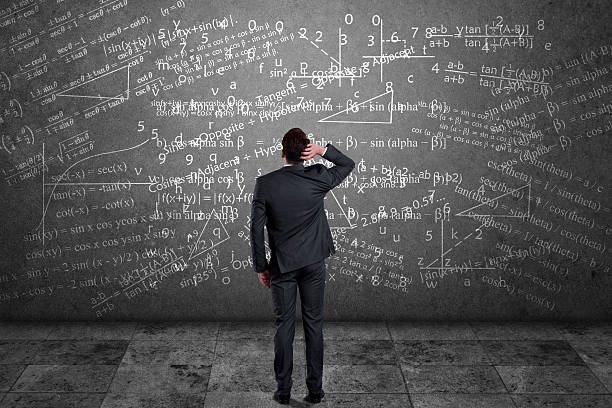 businessman solving mathematical equation - complexity stock photos and pictures