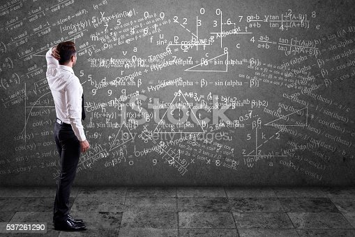 istock Businessman solving mathematical equation 537261290