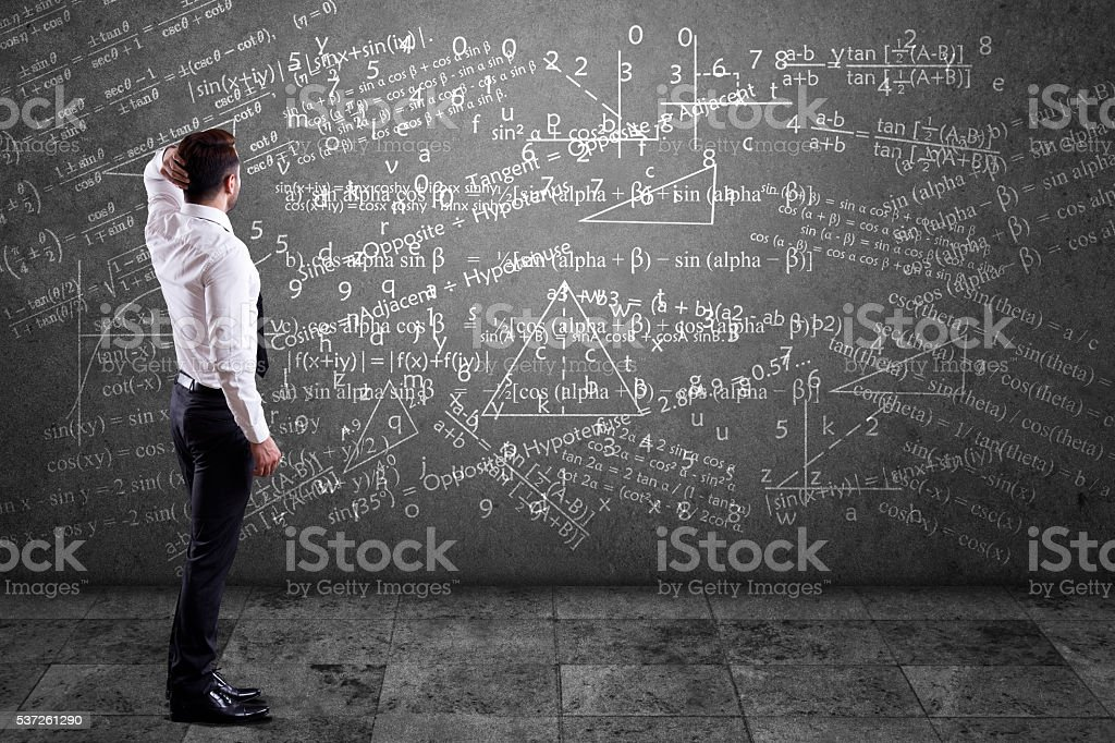 Businessman solving mathematical equation stock photo