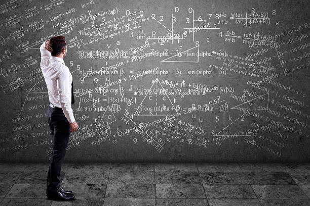 businessman solving mathematical equation - math class stock photos and pictures